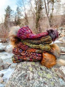 5 beanies stacked on a rock from Smeeny Beanie Knits